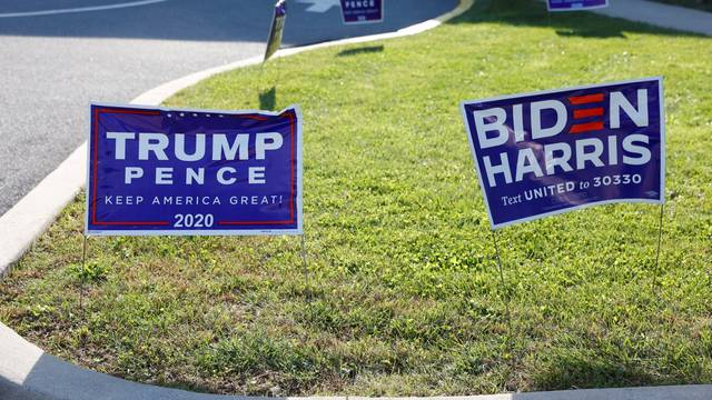 FILE PHOTO: Campaign signs of U.S. President Donald Trump and presidential nominee and former Vice President Joe Biden are seen on Election Day in Cherryville, Pennsylvania