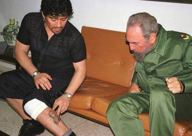 FILE PHOTO: Argentine legend Maradona meeting with Fidel Castro