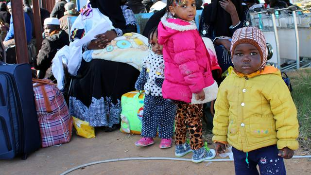 Migrants from Niger wait before they are deported by Libyan authorities, in Misrata