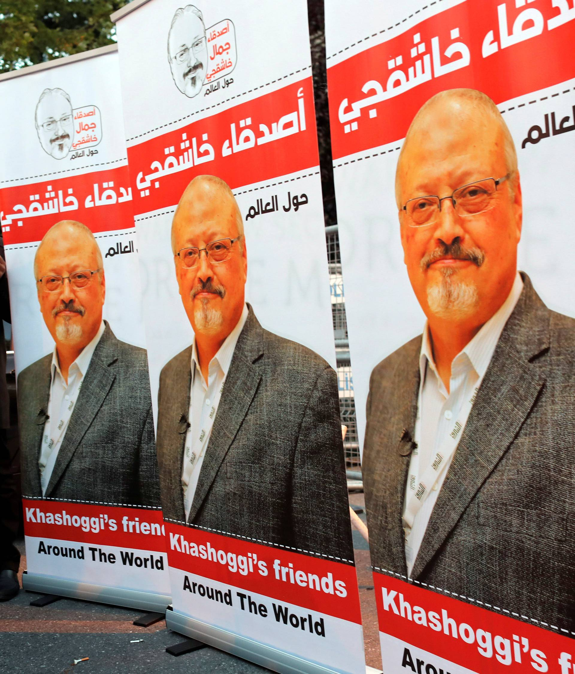Friends of Saudi journalist Khashoggi hold posters and banners with his pictures during a demonstration outside the Saudi Arabia consulate in Istanbul