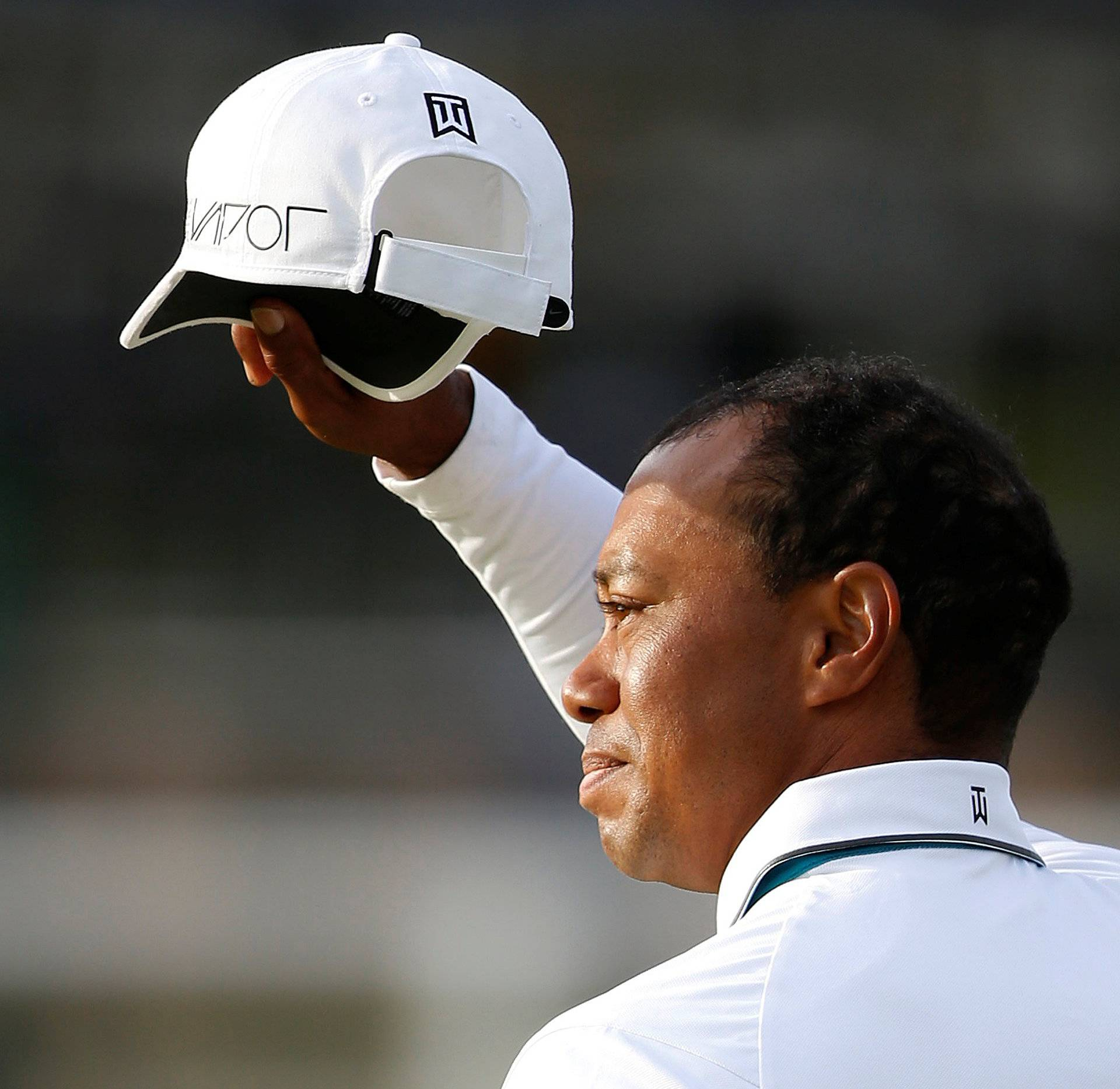 FILE PHOTO: Woods of the U.S. acknowledges the crowd as he walks off the 18th green during the second round of the British Open golf championship on the Old Course in St. Andrews, Scotland