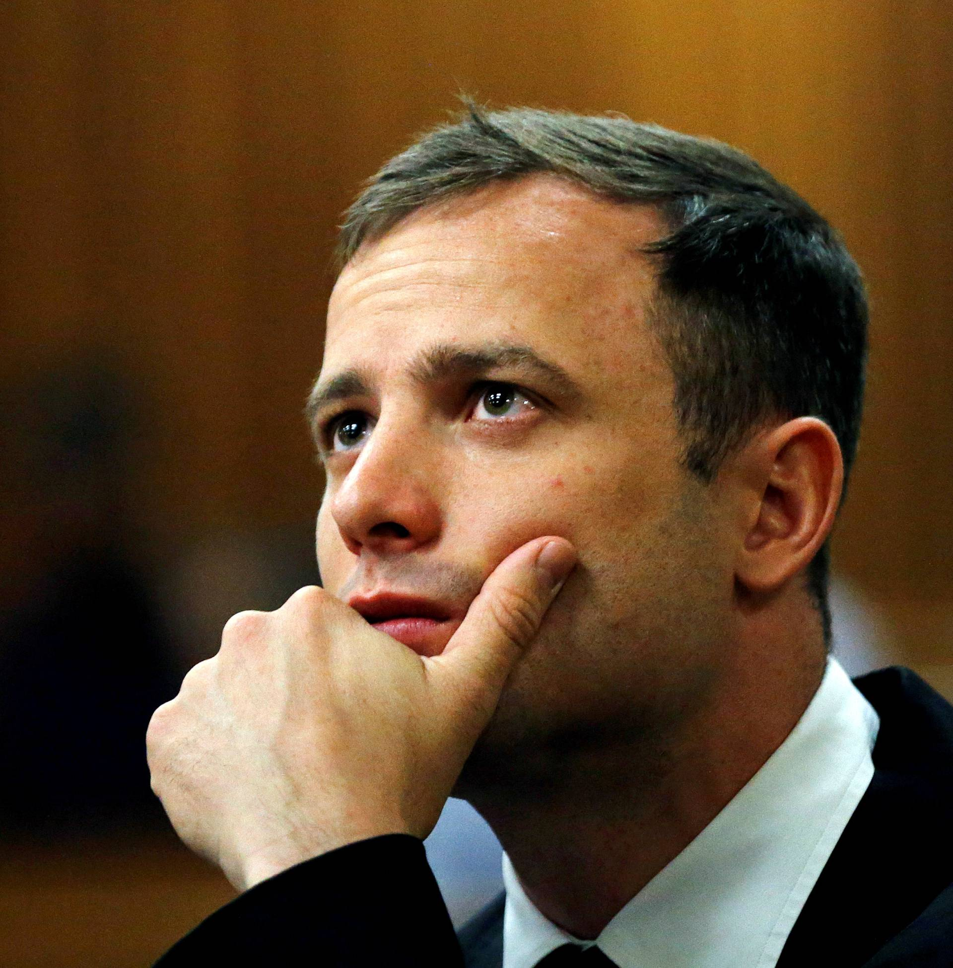 FILE PHOTO: Olympic and Paralympic track star Oscar Pistorius looks on ahead of his sentencing hearing in Pretoria