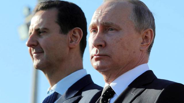 Russian President Putin and Syrian President Bashar al-Assad visit the Hmeymim air base in Latakia Province