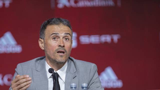 Luis Enrique attends a press conference as he returns as Spain head coach