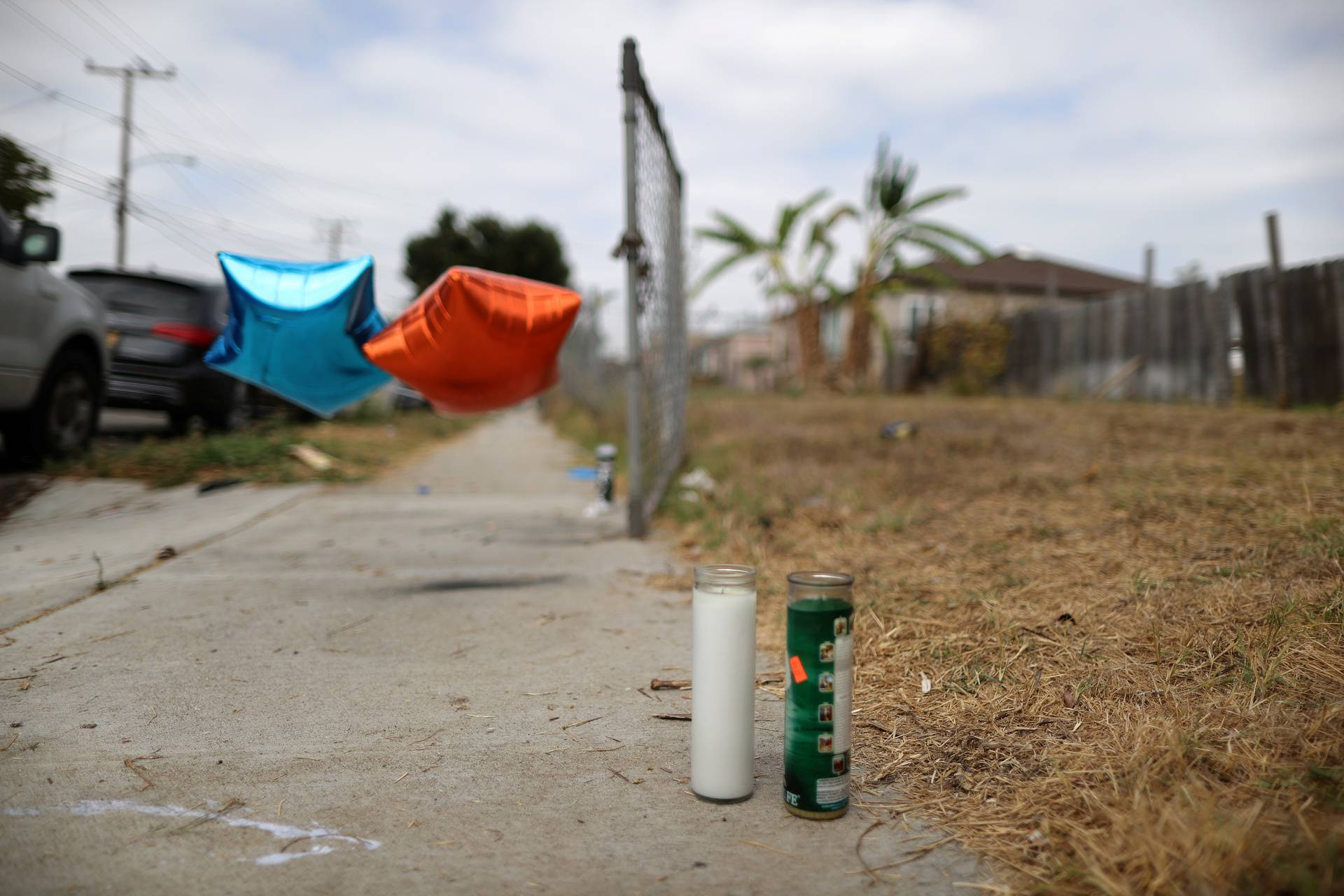 Candles are seen on the sidewalk where Dijon Kizzee, 29, was shot by Los Angeles sheriff's deputies, in Los Angeles