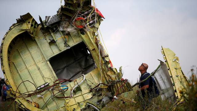 FILE PHOTO: A Malaysian air crash investigator inspects the crash site of Malaysia Airlines Flight MH17, near the village of Hrabove (Grabovo) in Donetsk region