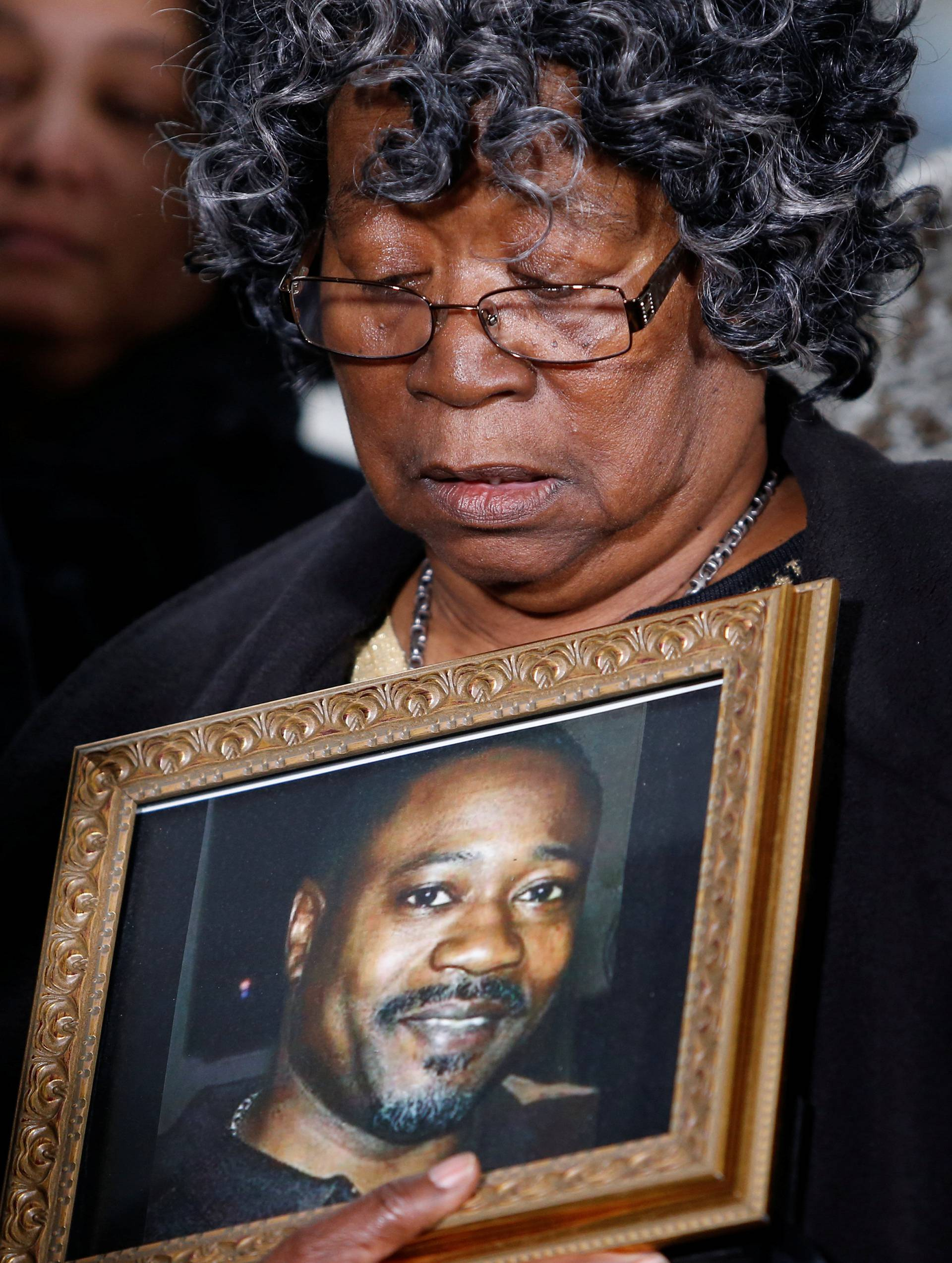 Judy Scott looks over a photo of her son Walter Scott during a news conference after former police officer Michael Slager was sentenced to 20 years in prison, in Charleston
