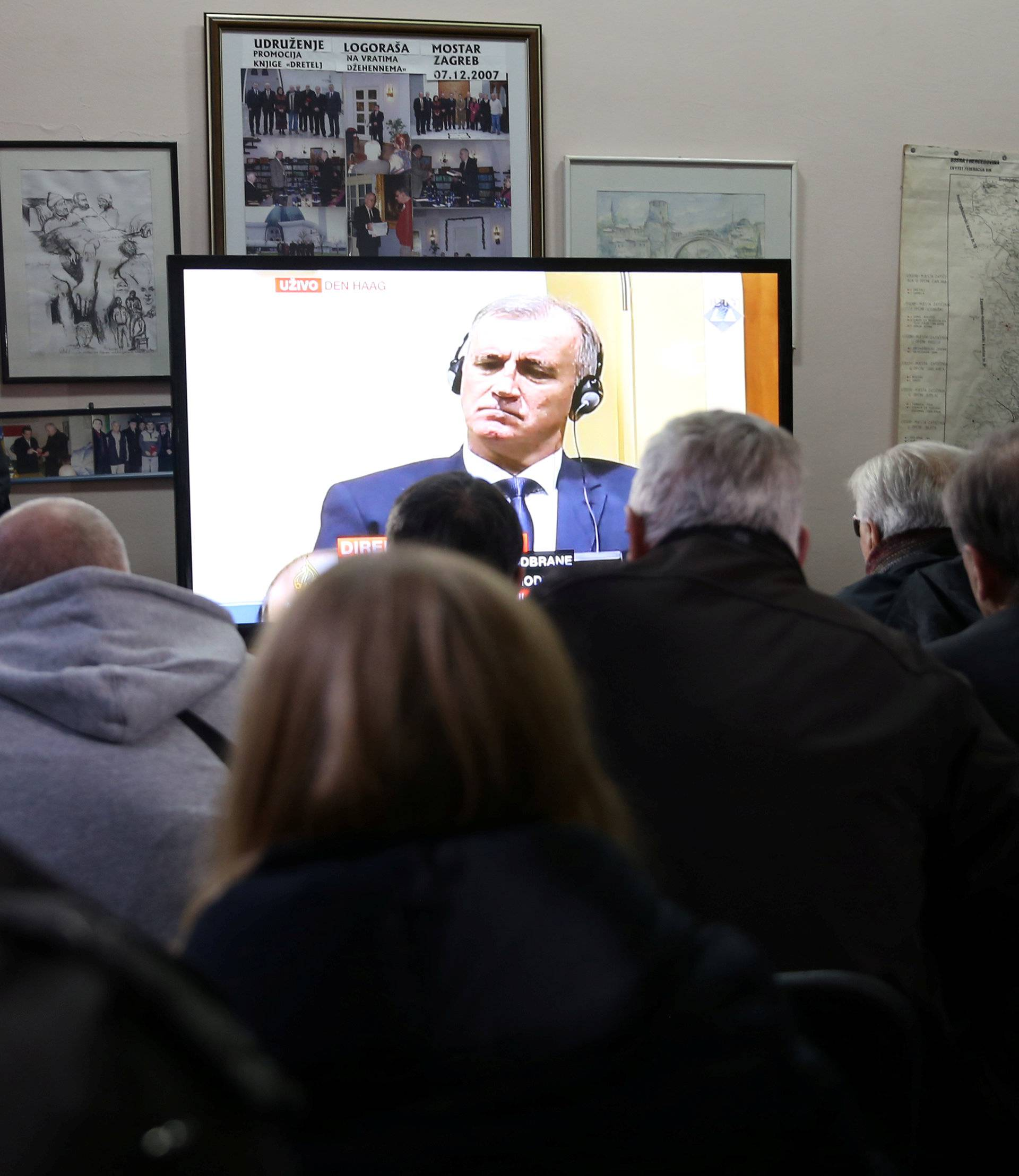 Union of former detainees watch a television broadcast of the appeal trial in the Hague, Netherlands, for six Bosnian Croat senior wartime officials accused of war crimes against Muslims in Bosnia's 1992-1995 war, in Mostar