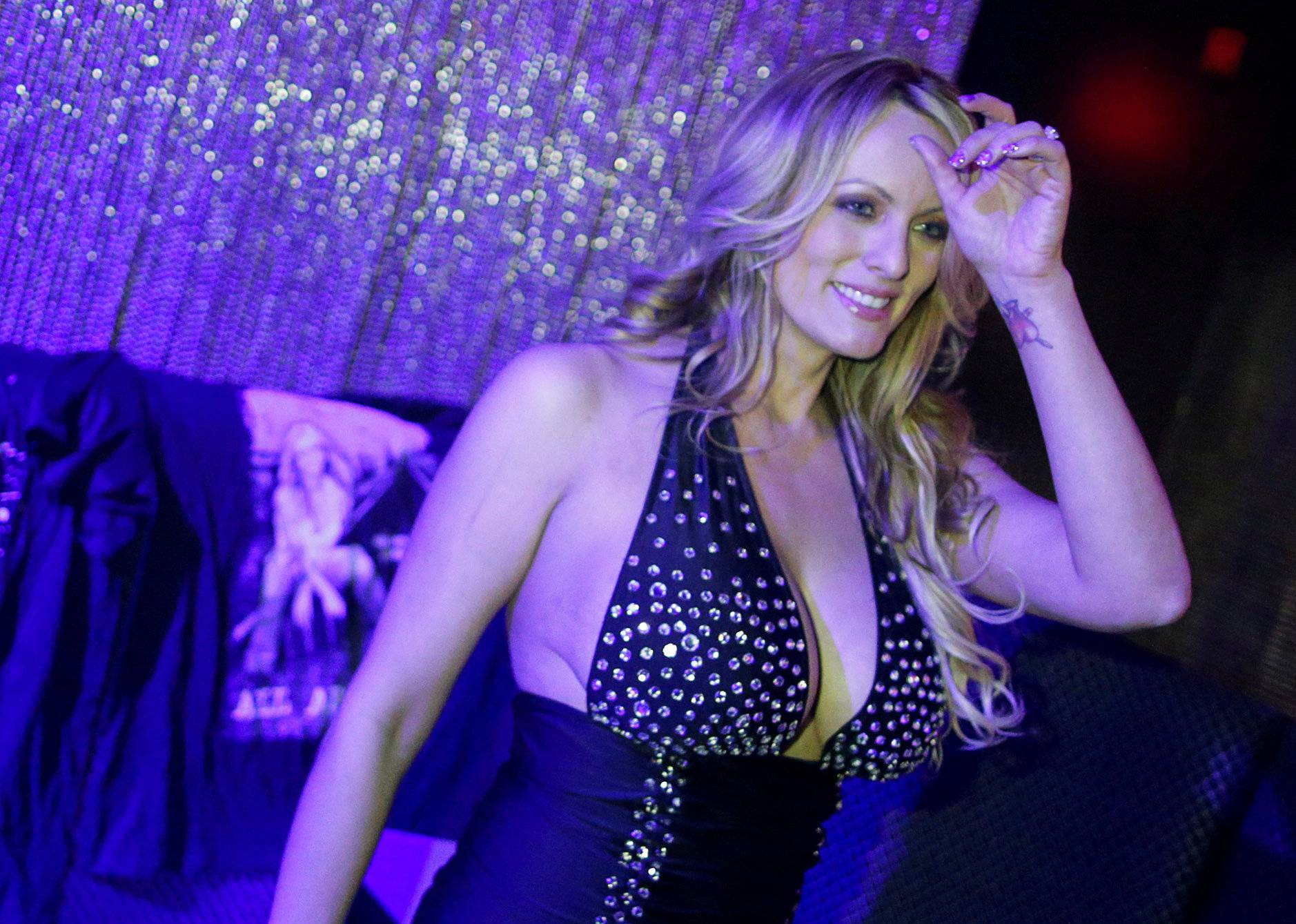 FILE PHOTO: Adult-film actress Clifford, also known as Stormy Daniels, poses for pictures at the end of her striptease show in Gossip Gentleman club in Long Island, New York