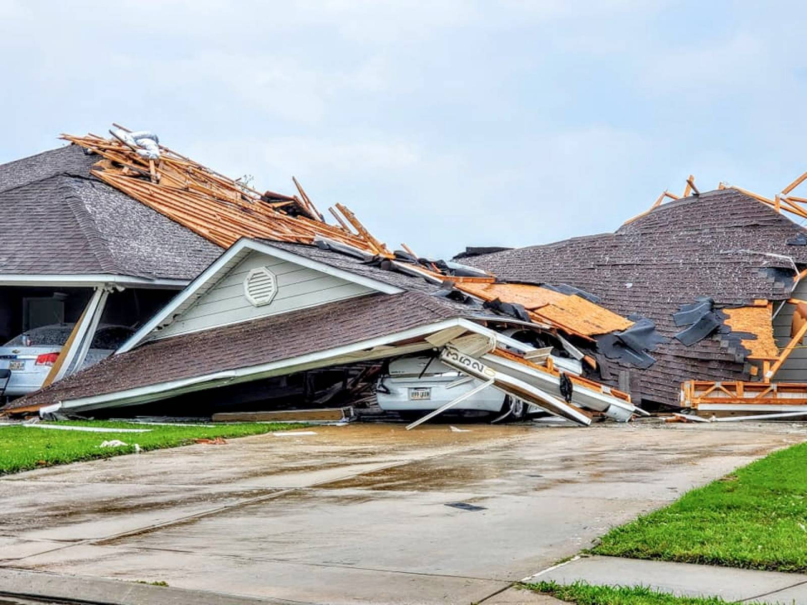 Social media images of damaged buildings and vehicles in the aftermath of a tornado in Monroe, Louisiana