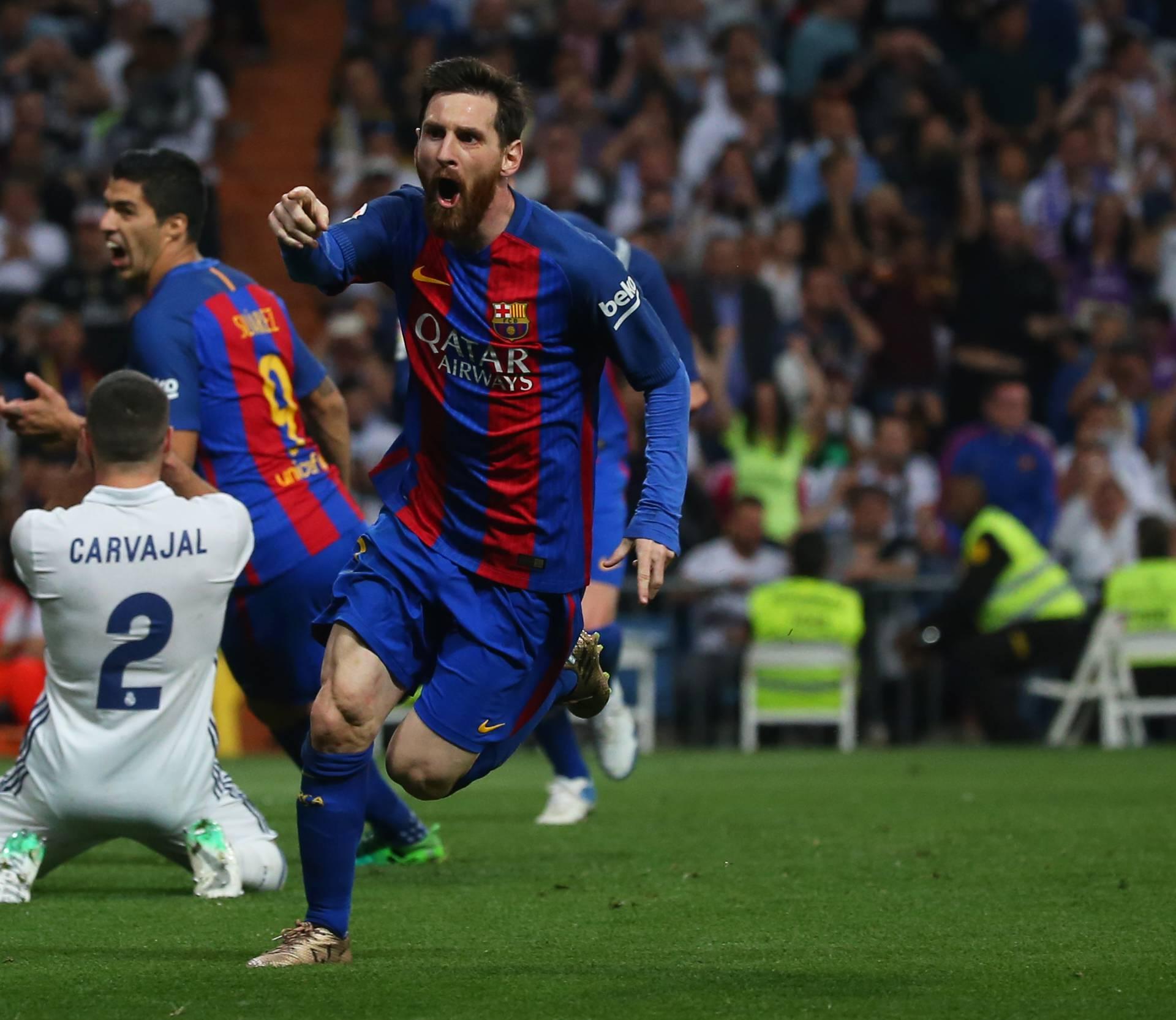 Barcelona's Lionel Messi celebrates scoring their third goal