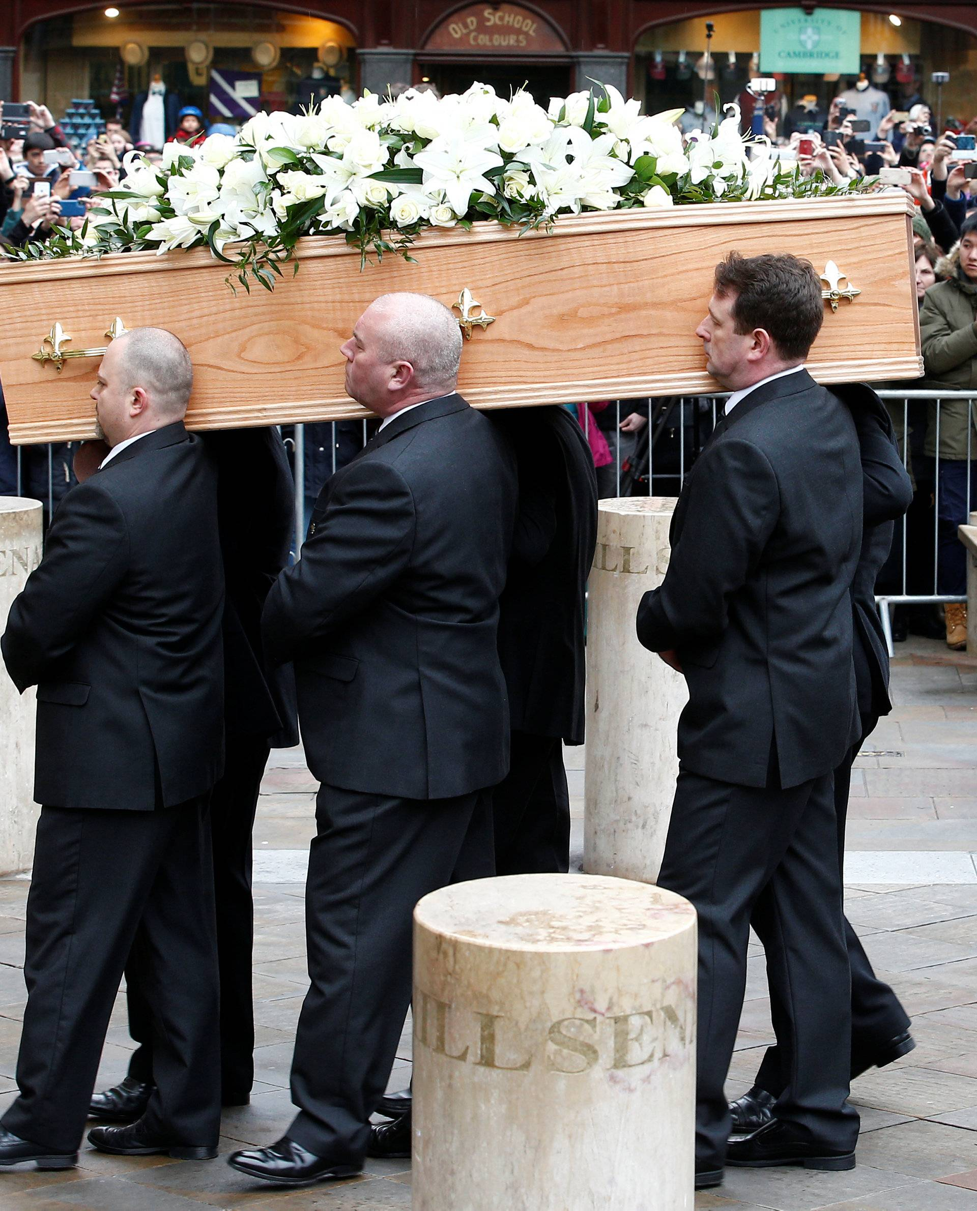 Pallbearers carry the coffin into Great St Marys Church, where the funeral of theoretical physicist Prof Stephen Hawking is being held, in Cambridge