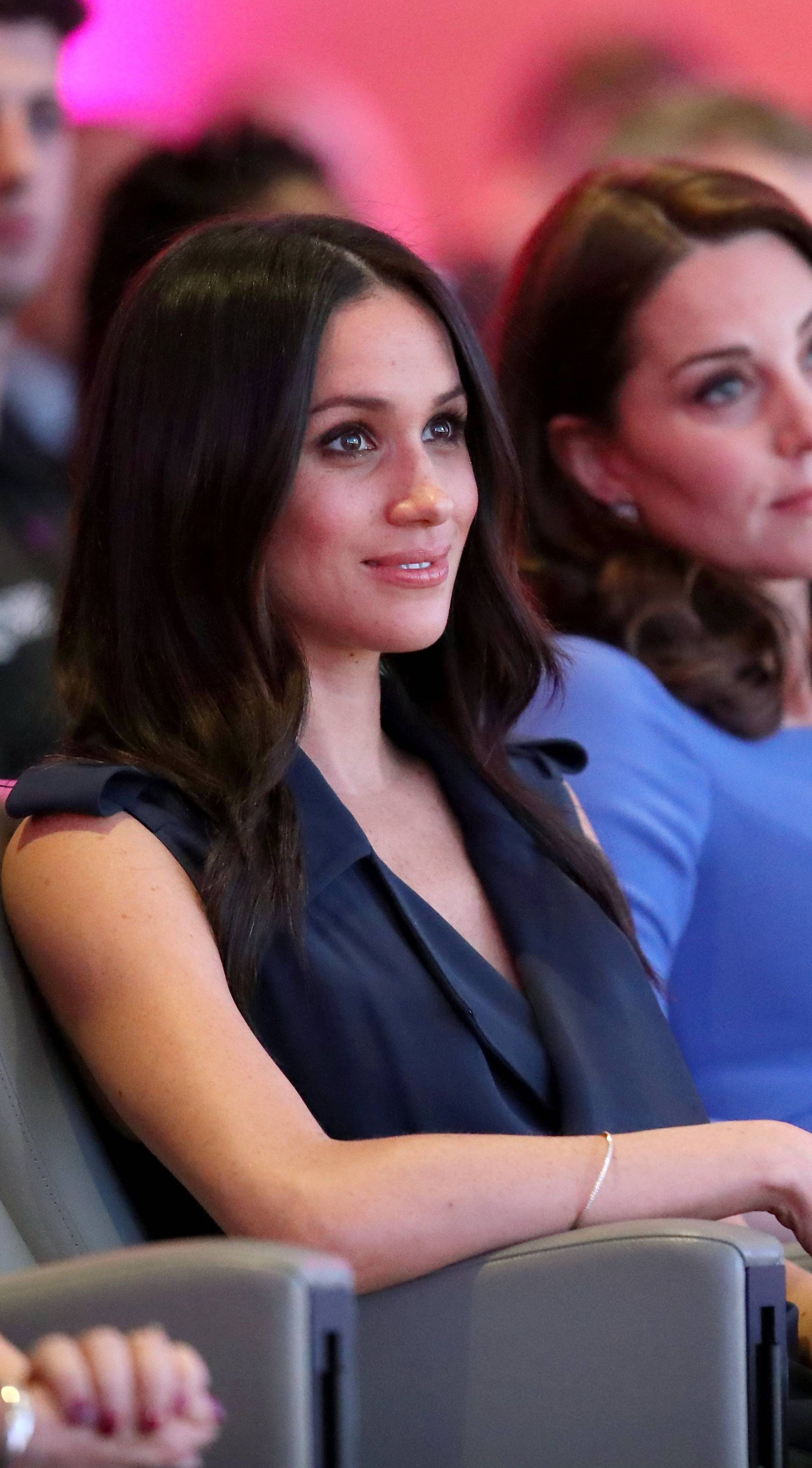 Britain's Catherine, Duchess of Cambridge and Prince Harry's fiancee Meghan Markle attend the first annual Royal Foundation Forum held at Aviva in London