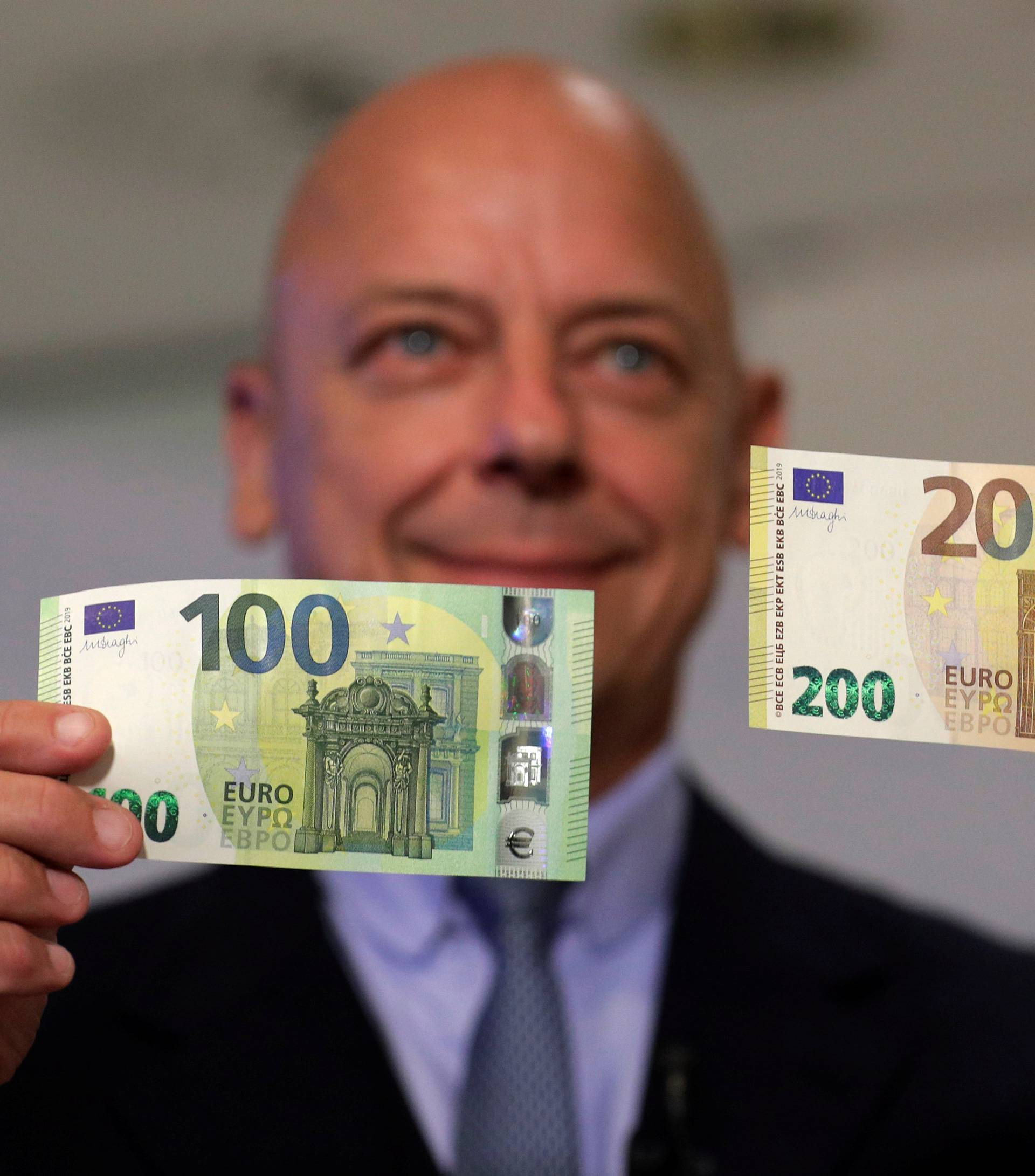 Austrian Central Bank Director Kurt Pribil displays new 100 and 200 euro banknotes in Vienna
