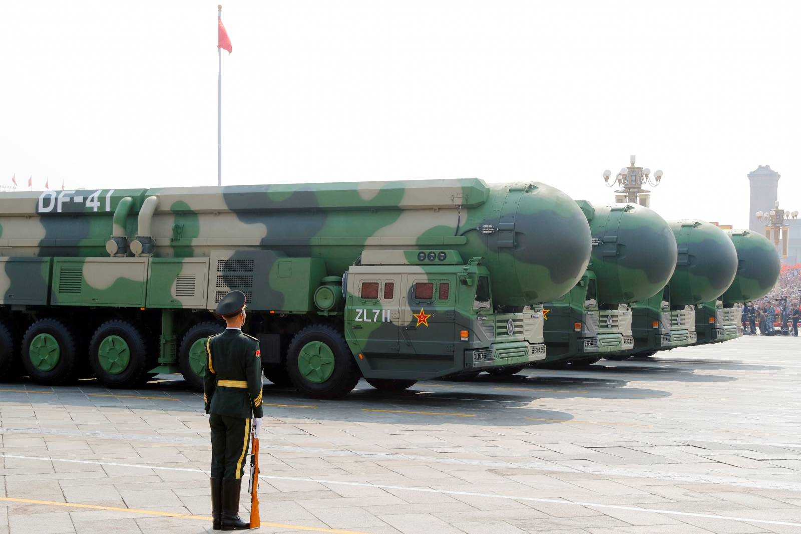 Military vehicles carrying DF-41 intercontinental ballistic missiles travel past Tiananmen Square during the military parade marking the 70th founding anniversary of People's Republic of China
