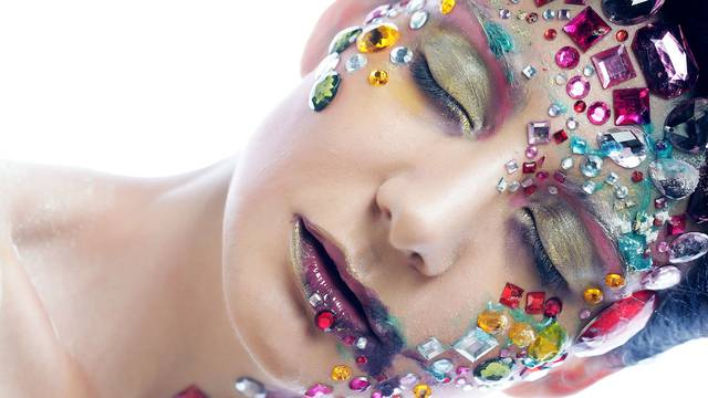 Closeup portrait of woman with artistic make-up.