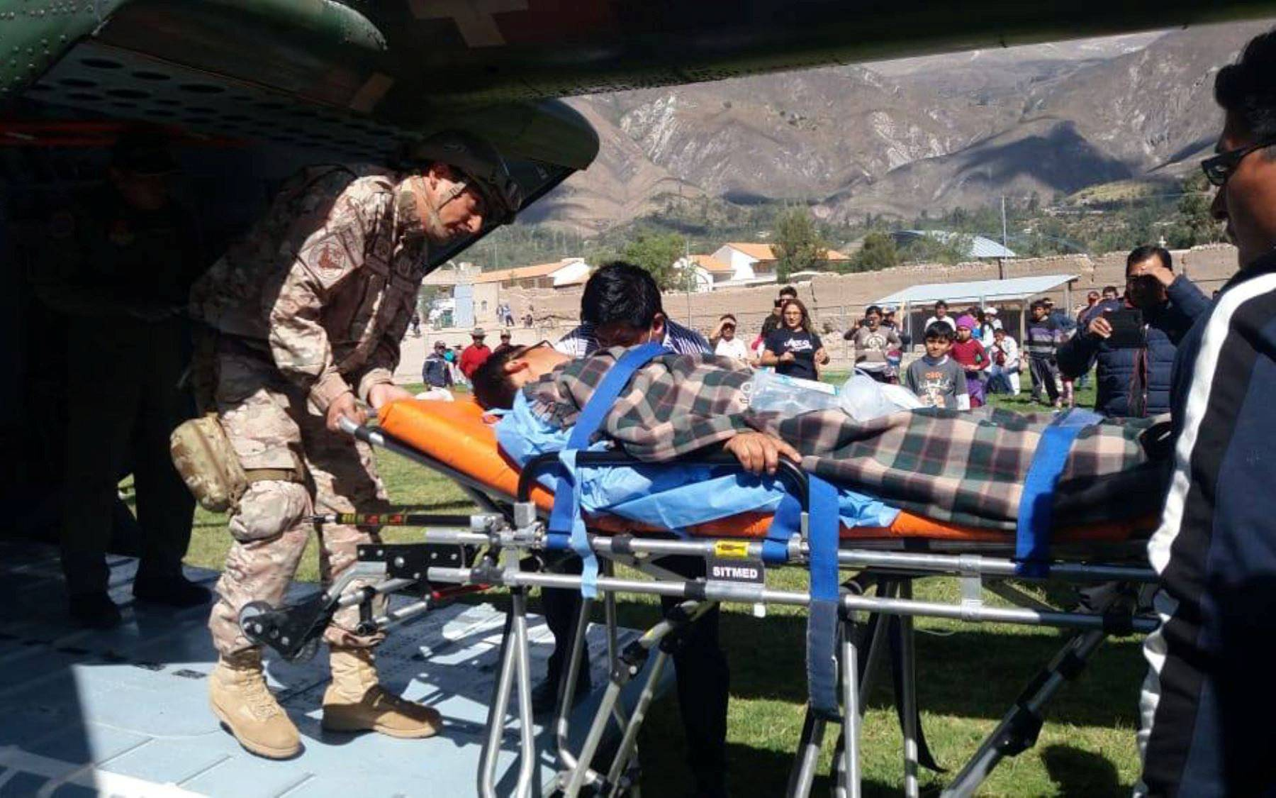 A person is transported to a helicopter after eating contaminated food at a funeral in the Peruvian Andes, in Ayacucho