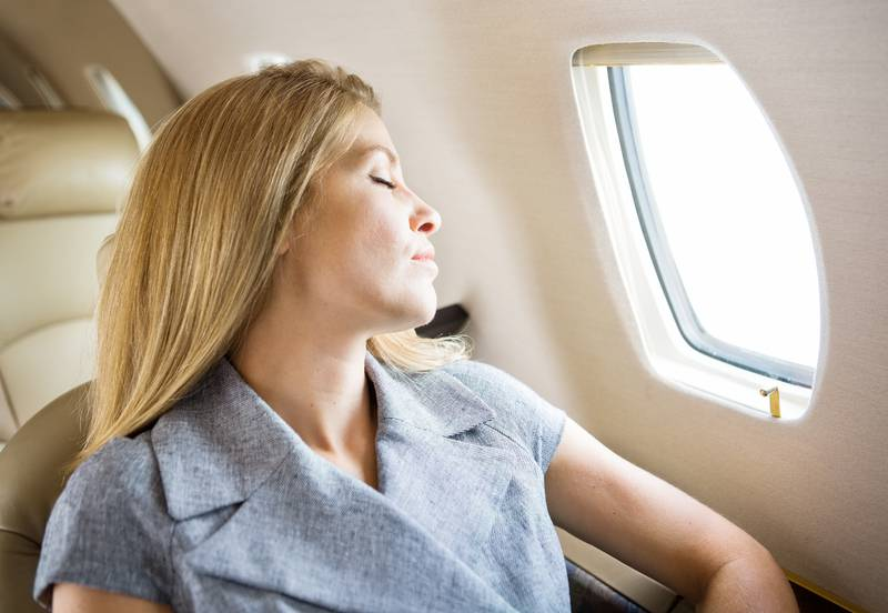 Businesswoman Sleeping In Private Jet
