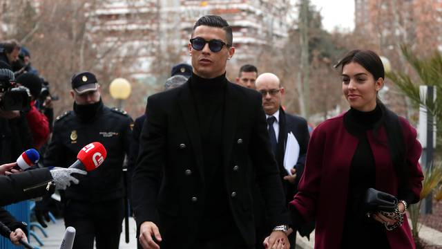 Portugal's soccer player Cristiano Ronaldo arrives to appear in court on a trial for tax fraud in Madrid