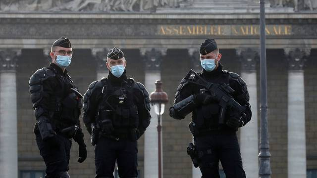 French gendarmes stand guard in front of the National Assembly in Paris
