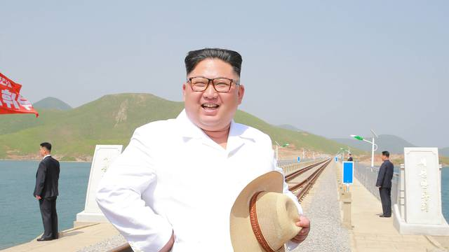 North Korean leader Kim Jong Un inspects the completed railway that connects Koam and Dapchon, in this undated photo released by North Korea's Korean Central News Agency
