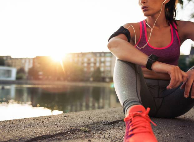 Young,Woman,Runner,Resting,After,Workout,Session,On,Sunny,Morning.