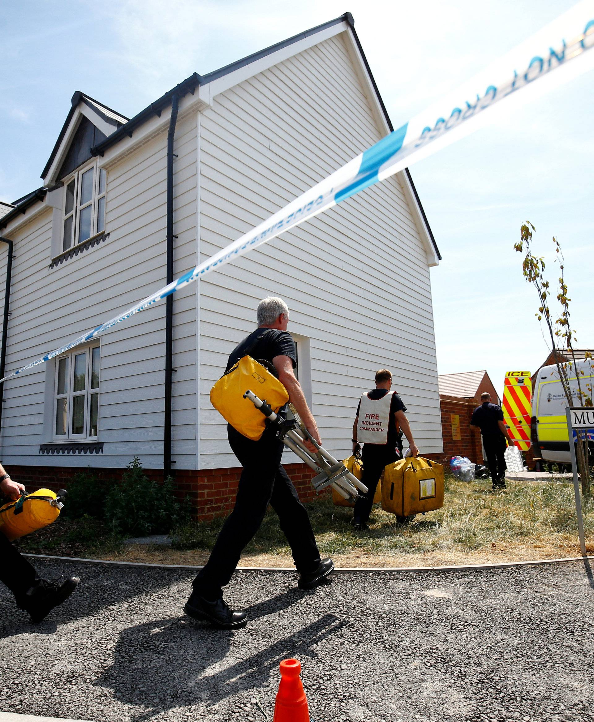 FILE PHOTO: Fire and Rescue Service personel arrive with safety equipment at the site of a housing estate on Muggleton Road, after it was confirmed that two people had been poisoned with the nerve-agent Novichok, in Amesbury