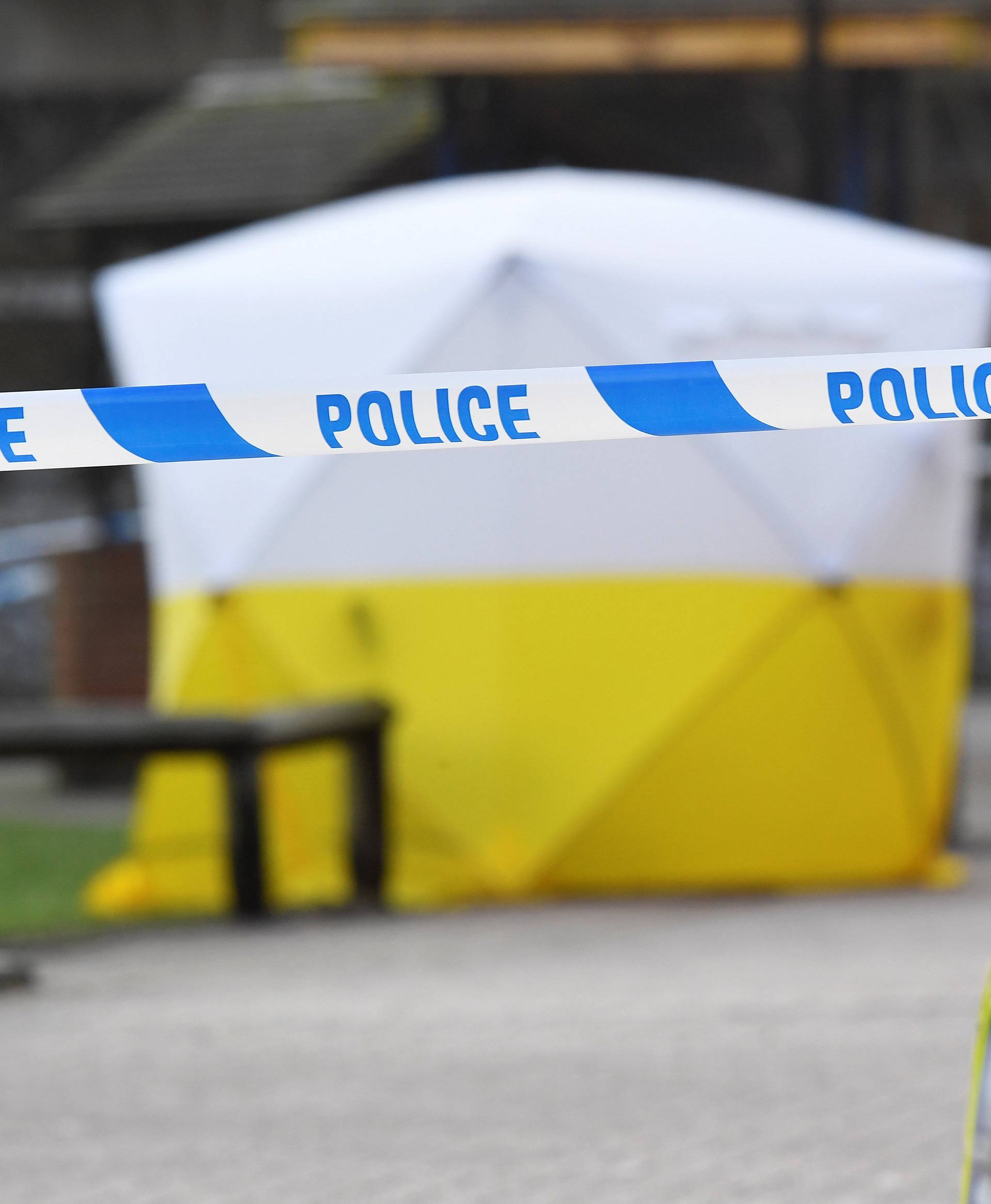 A police car is parked next to crime scene tape, as a tent covers a park bench on which former Russian inteligence officer Sergei Skripal, and a woman were found unconscious after they had been exposed to an unknown substance, in Salisbury