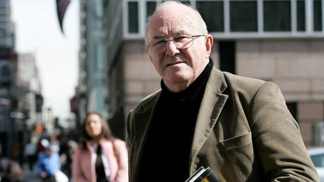"FILE PHOTO: Author Clive James poses with copy of his latest book ""Cultural Amnesia"" in New York"