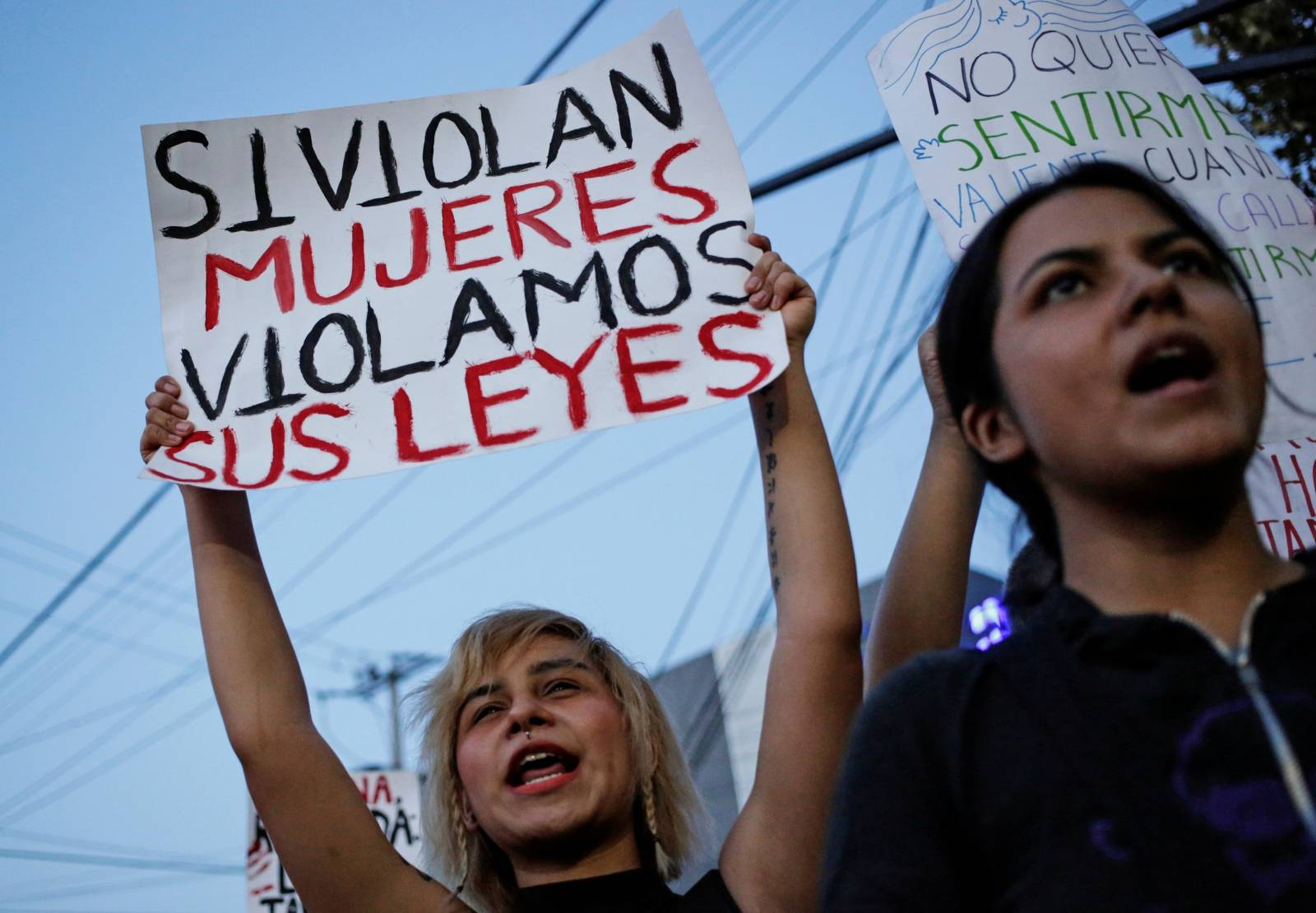 Women demonstrate at the They Don't Protect Me, They Rape Me protest to demand justice for two teenage girls that local media reported were apparently raped by policemen, outside the Nuevo Leon's Attorney General's office in Monterrey