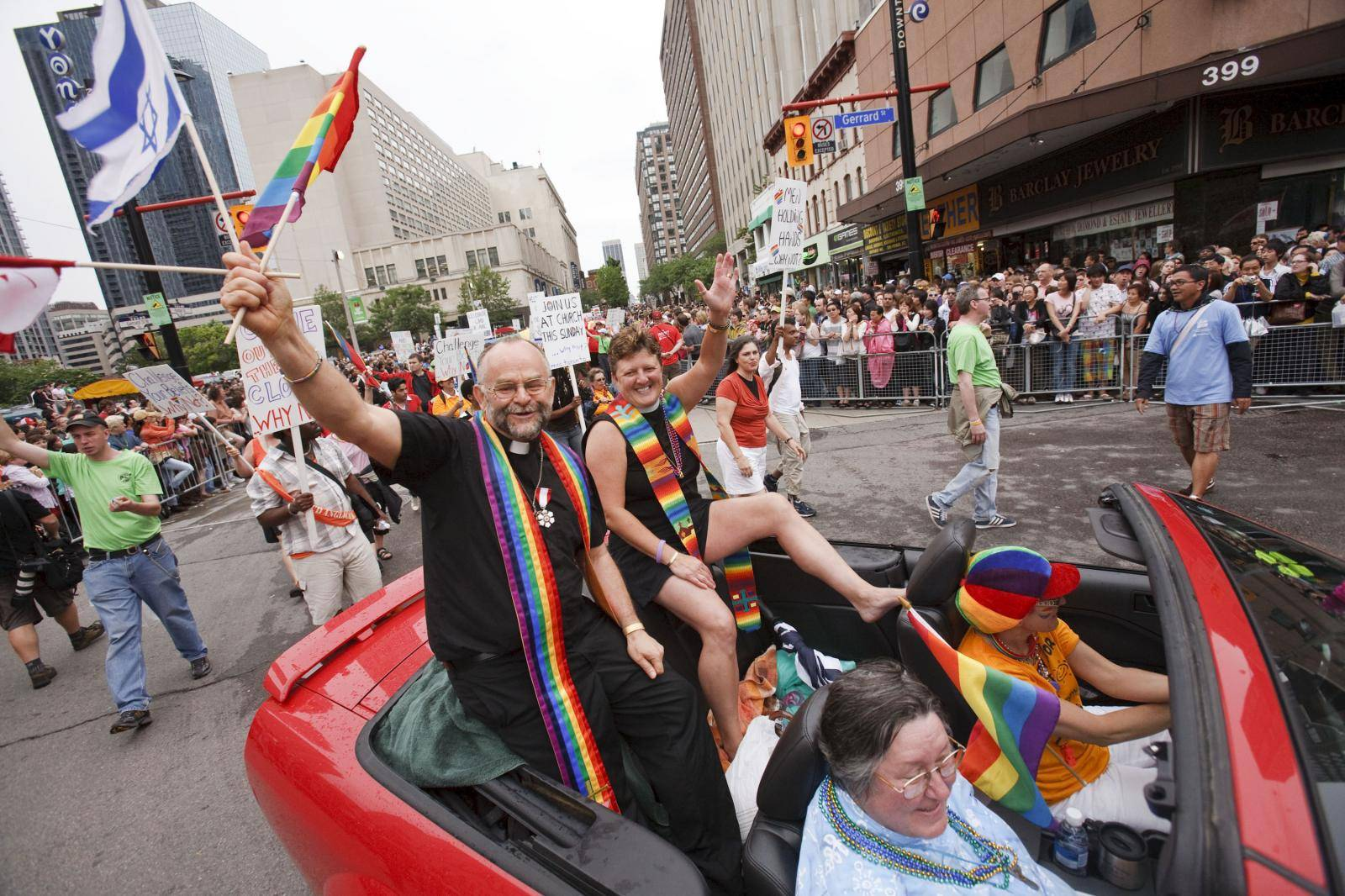 The Rev. Dr. Brent Hawkes & Rev. Jo Bell from the Metropolitan Community Church of Toronto ride down Yonge Street in the 29th Annual Pride Parade, Toronto, Canada.