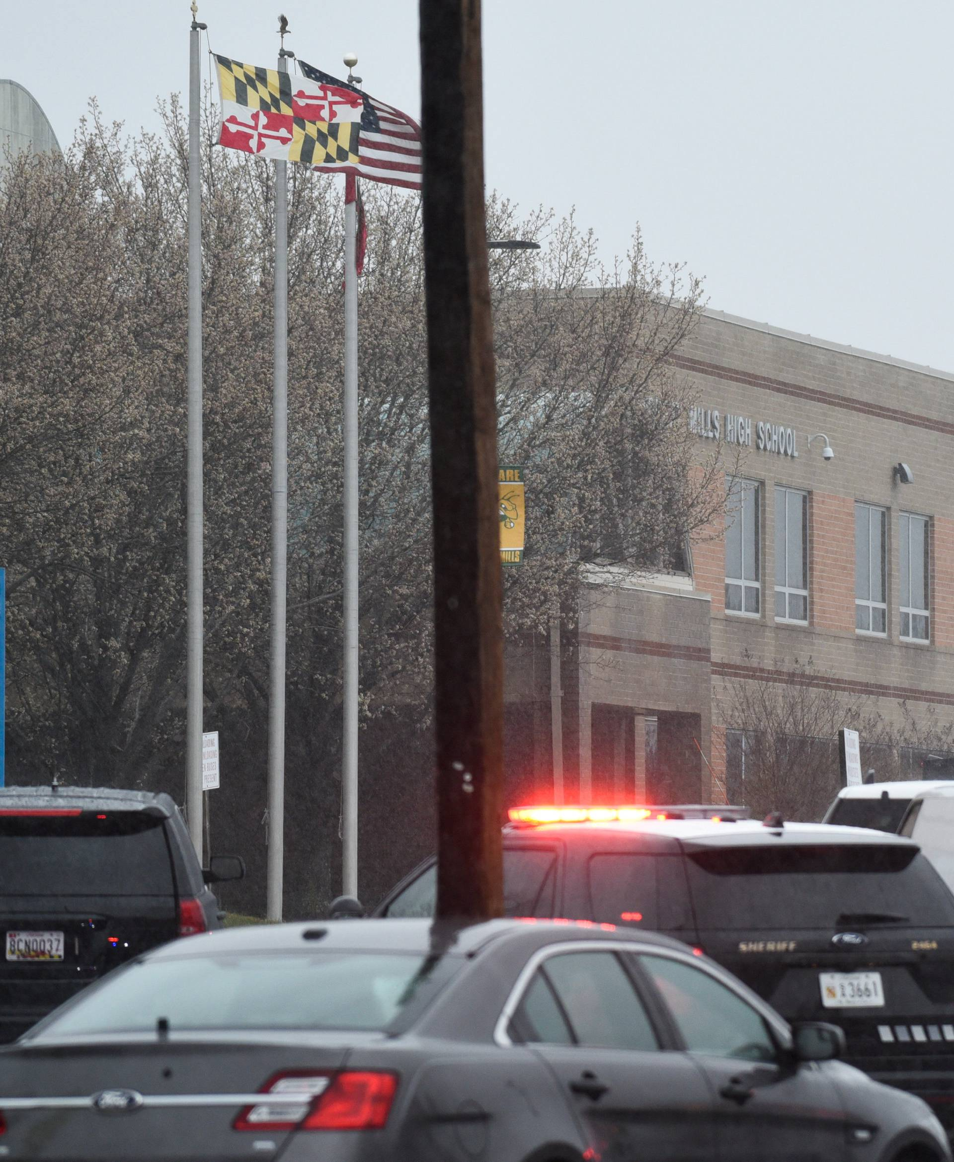 Emergency services and law enforcement vehicles are seen outside the Great Mills High School following a shooting on Tuesday morning in St. Mary's County, Maryland