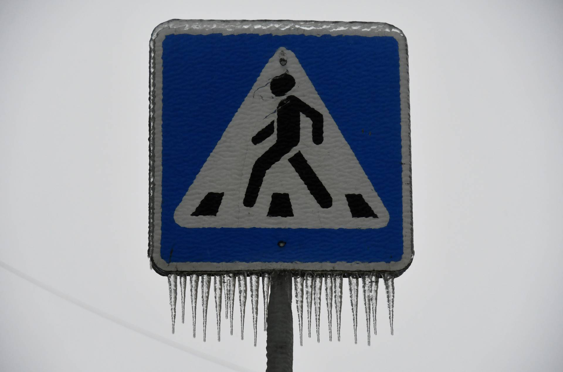 An ice covered road sign is pictured after freezing rain in the far eastern city of Vladivostok
