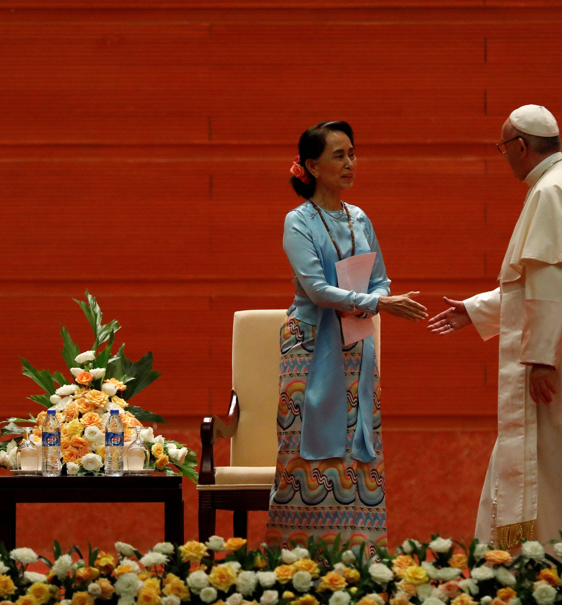 Pope Francis and Myanmars State Counsellor Aung San Suu Kyi shade hand as they attend a meeting with members of the civil society and diplomatic corps in Naypyitaw