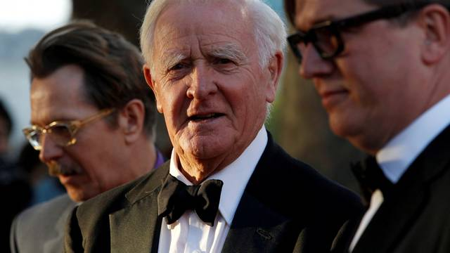 FILE PHOTO: British author John Le Carre poses for photographers with British actor Gary Oldman and Swedish director Tomas Alfredson at the UK premiere of Tinker Tailor Soldier Spy in London