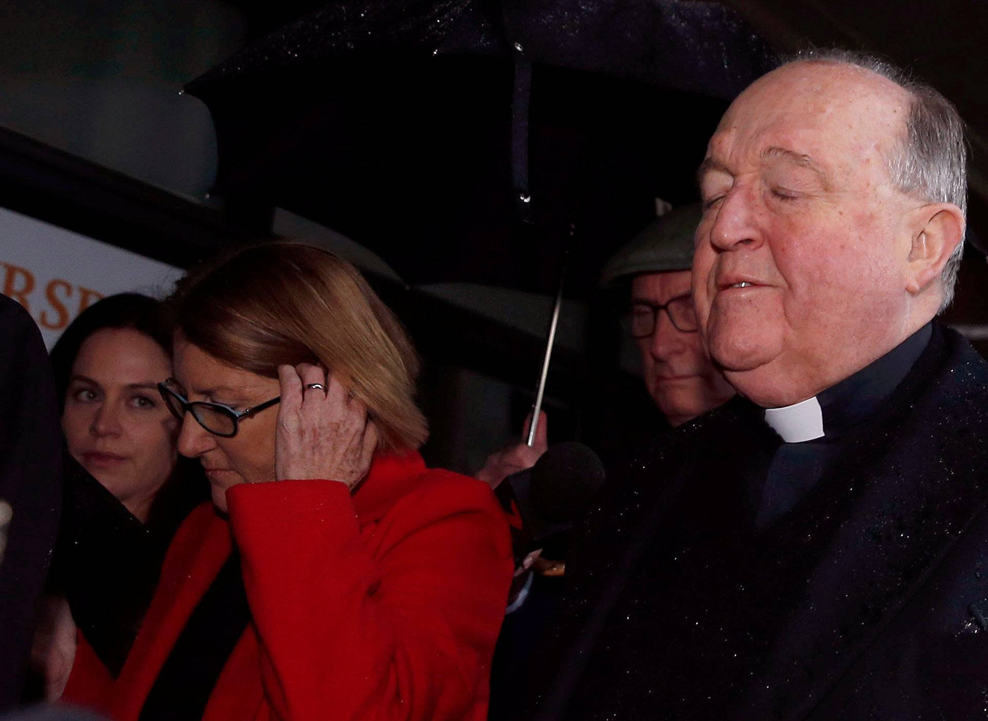 Archbishop Philip Wilson arrives at Newcastle Local Court, in Newcastle