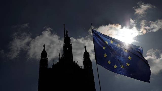 EU flag flutters outside the Houses of Parliament in London