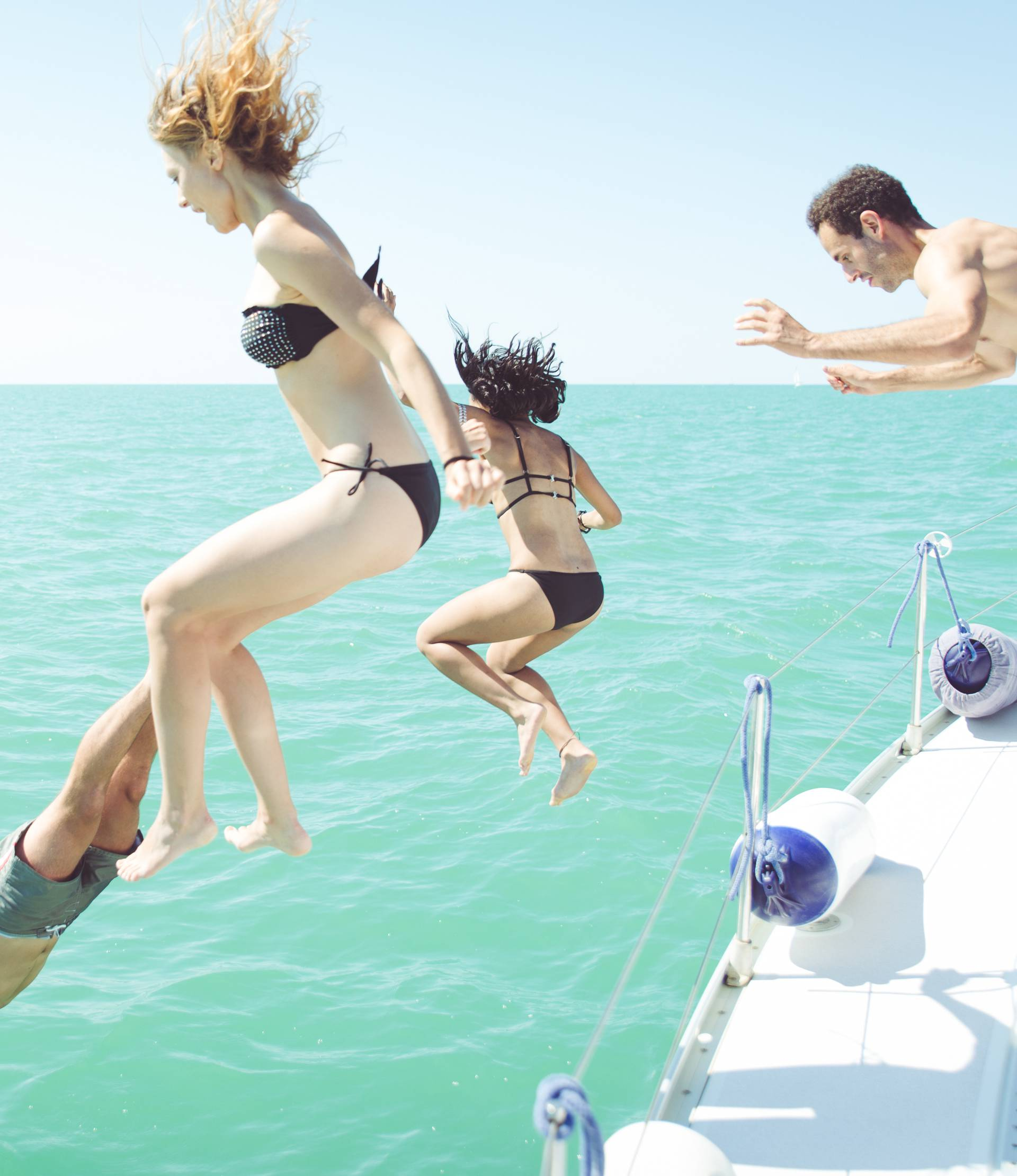 diving in the water during a boat excursion