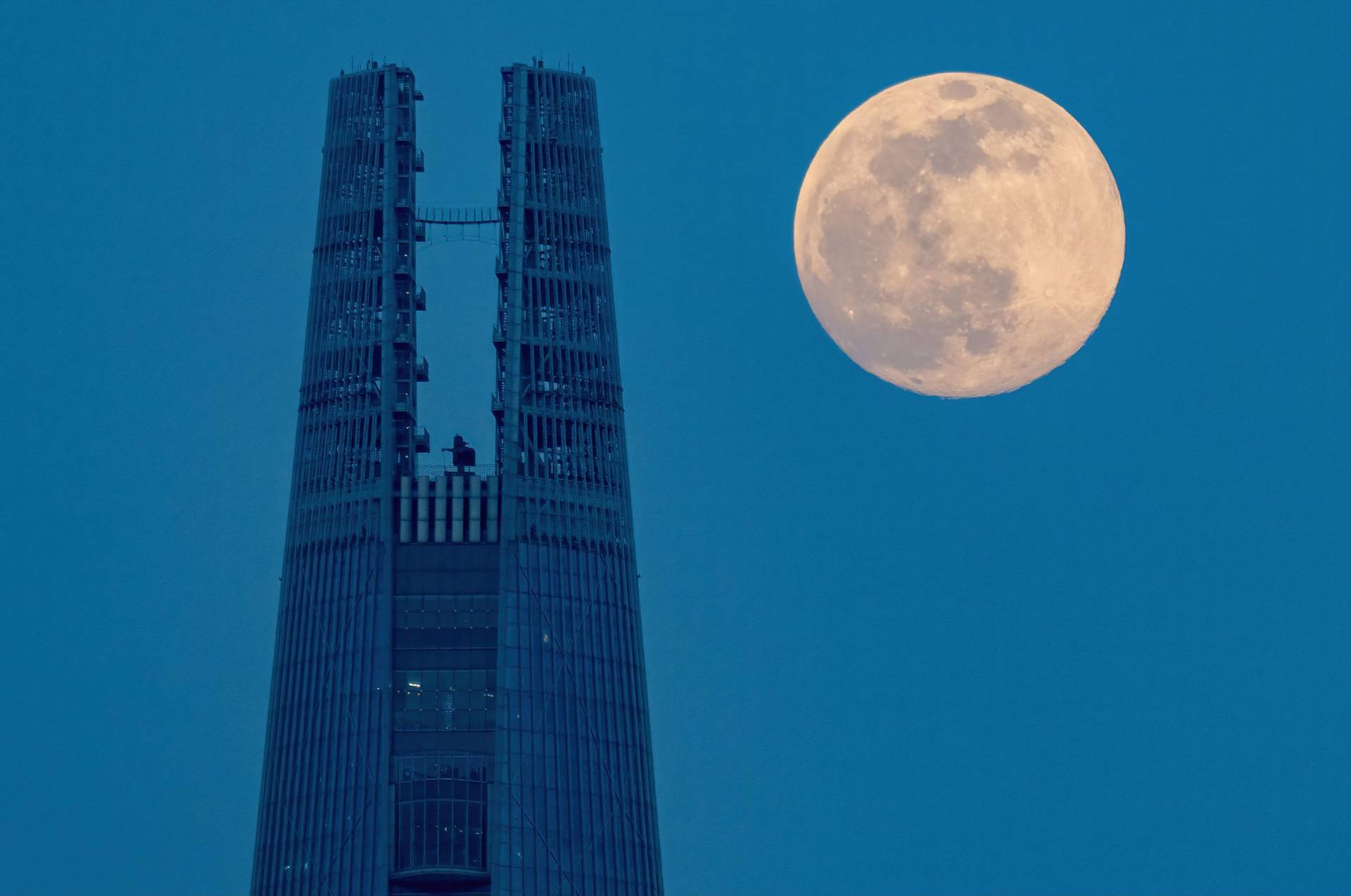 Lotte World Tower with moon, Seoul, South Korea - 26 Apr 2021