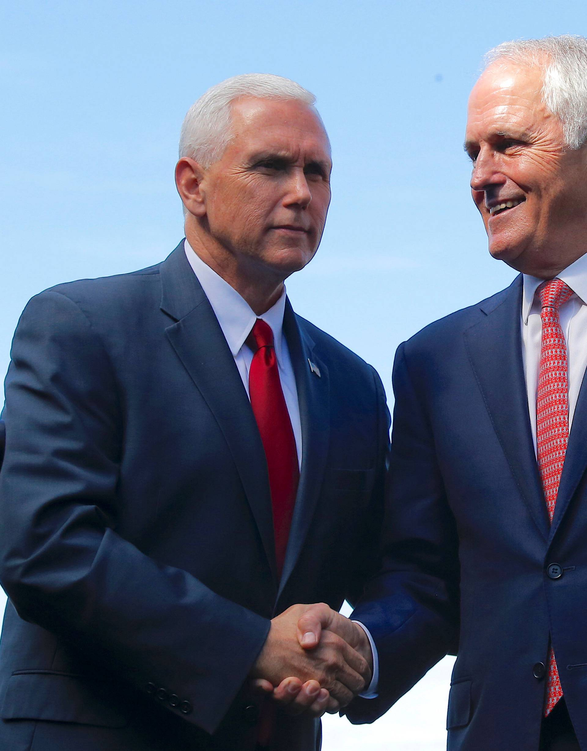 Pence shakes hands with Turnbull after a media conference at Admiralty House in Sydney