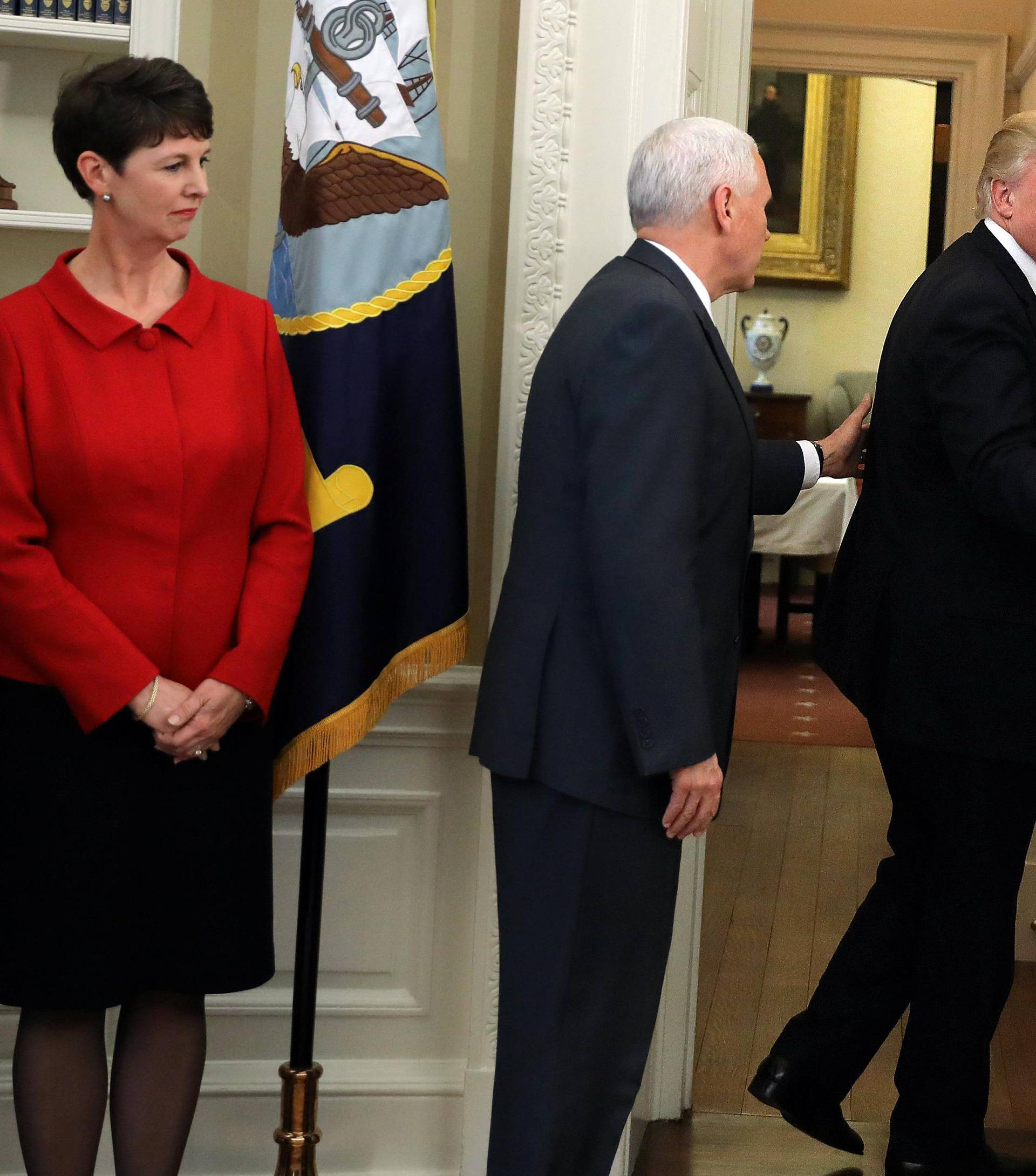 U.S. President Donald Trump leaves without signing executive orders on trade as Vice President Mike Pence reacts during a signing ceremony at the Oval Office of the White House in Washington, U.S.