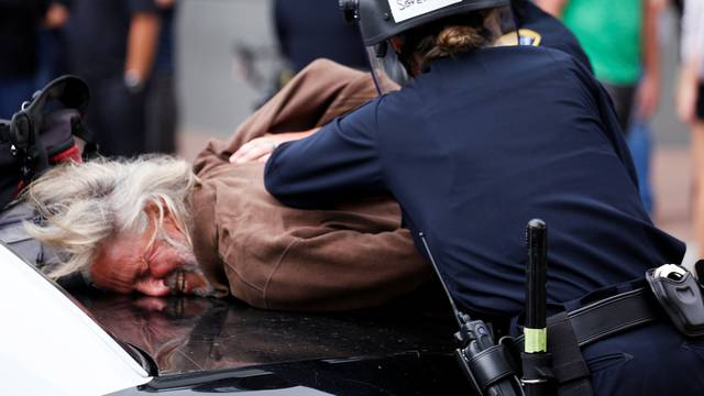 A man is arrested during a demonstration against Republican U.S. presidential candidate Donald Trump outside his campaign event in San Diego