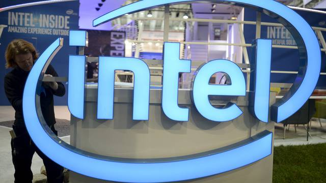 File photo of a worker arranging Intel logo at CeBIT trade fair in Hannover