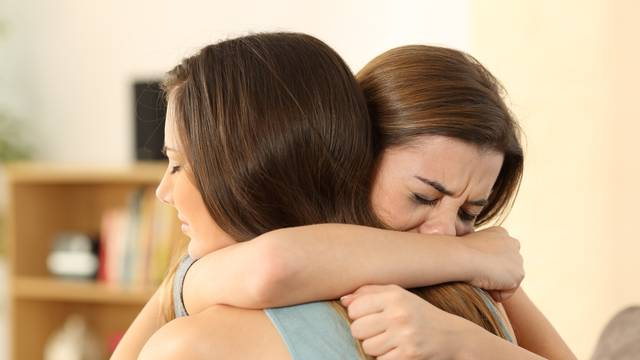Girl consoling to her sad best friend