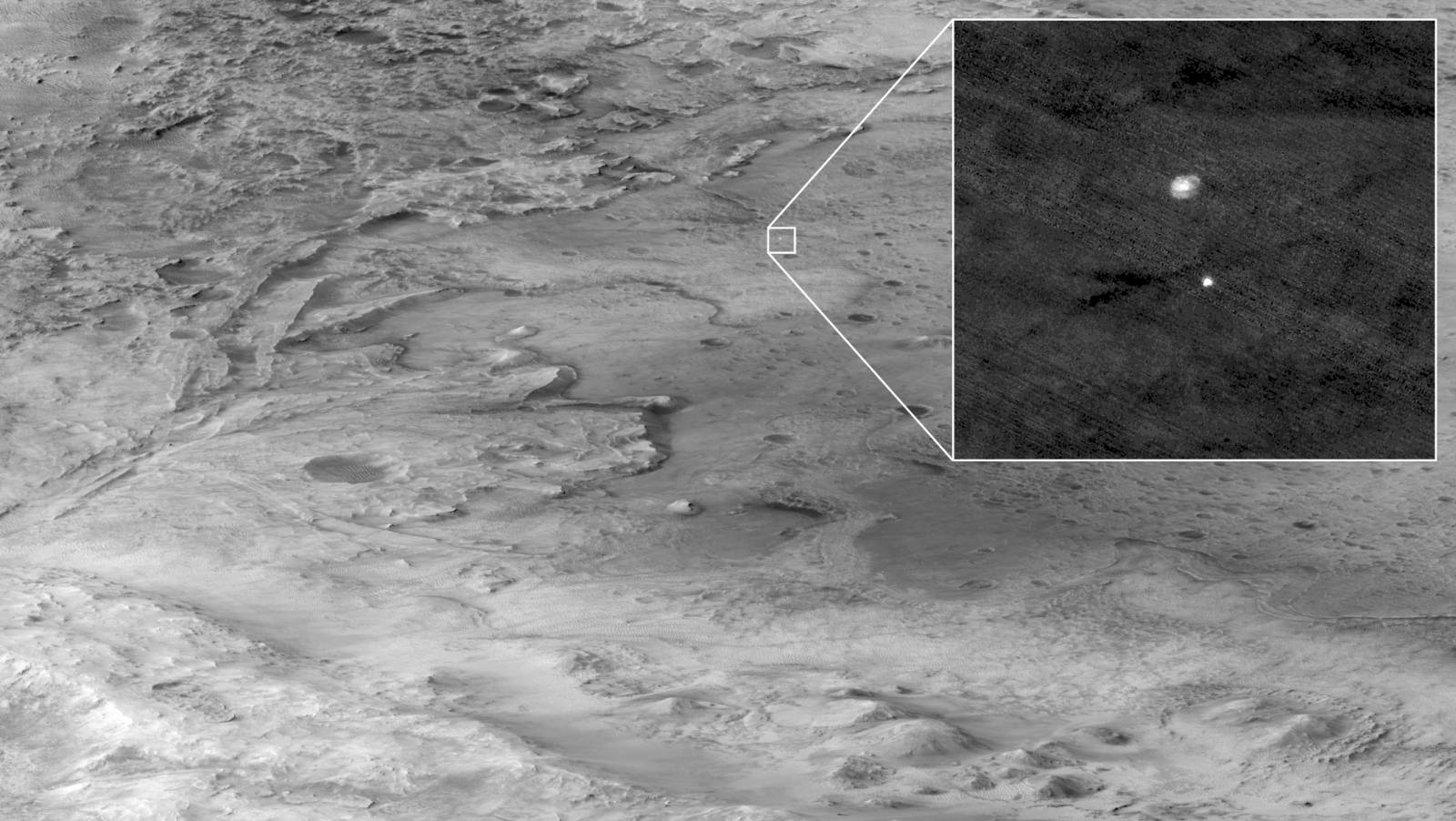 The descent stage holding NASA's Perseverance rover can be seen falling through the Martian atmosphere
