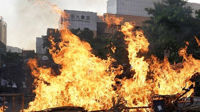 A barricade on fire is pictured during a demonstration by anti-government protesters in Sha Tin, Hong Kong