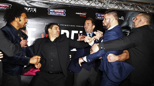 David Haye and Tony Bellew clash after the press conference as promoter Eddie Hearn looks on