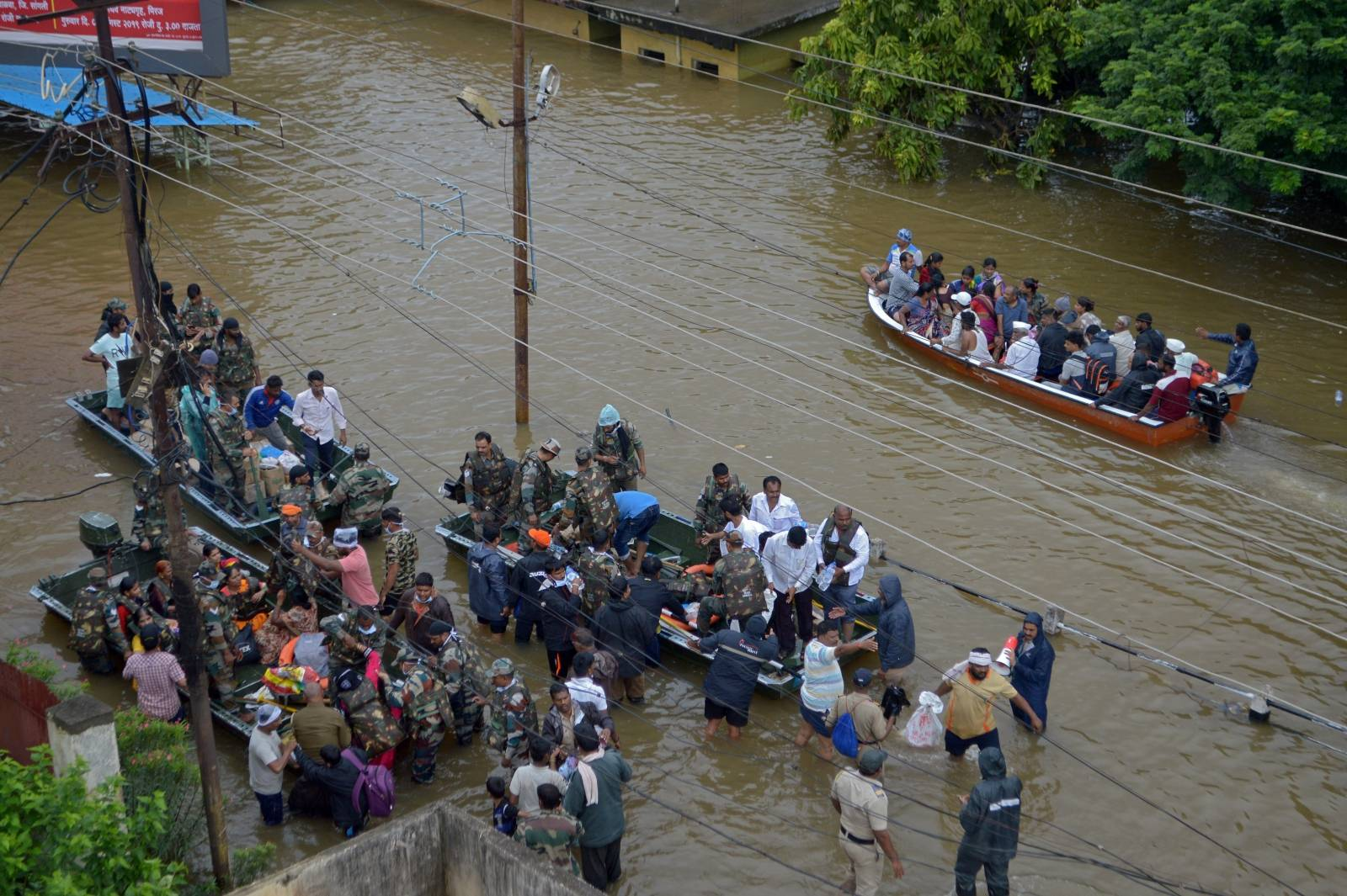 Army and Navy personnel evacuate flood-affected people to safer places in Sangli district