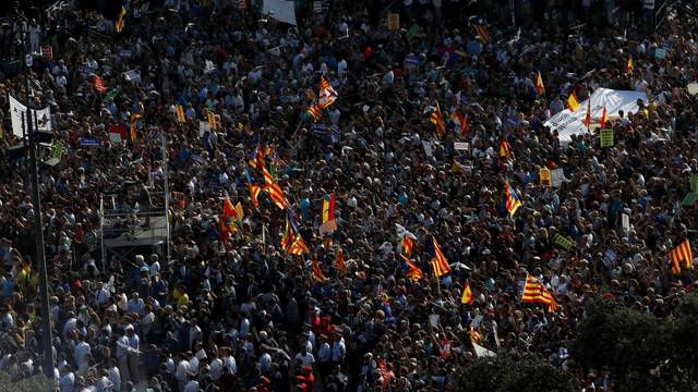 People gather at Plaza Catalunya as they take part in a march of unity after the attacks last week, in Barcelona, Spain