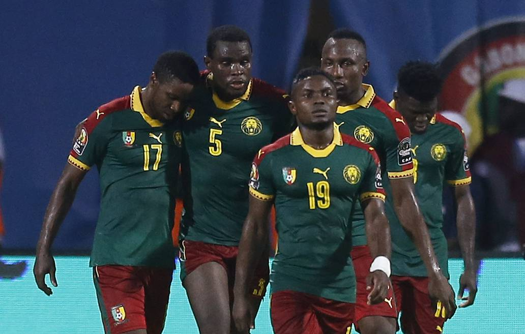 Cameroon's Michael Ngadeu-Ngadjui celebrates scoring their first goal with teammates
